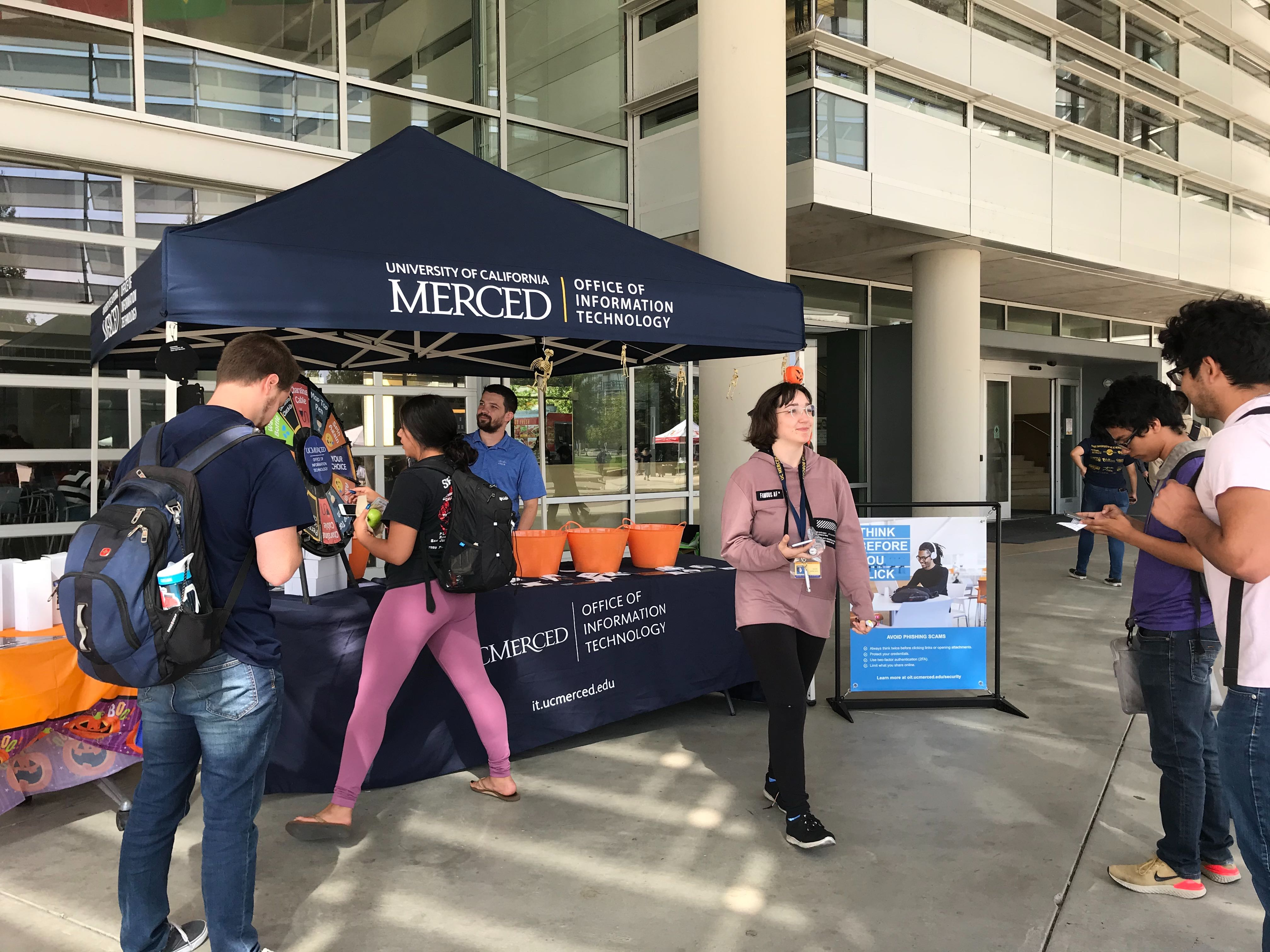 Students at the 2019 National Cyber Security Awareness Month Trivia Tent on the UC Merced campus.