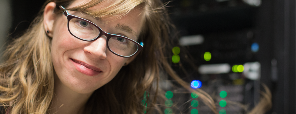 Faculty member smiling at camera. Click here to learn about OIT's research computing services